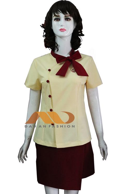 Đồng phục spa đầm vàng thắt nơ đỏ AS0137